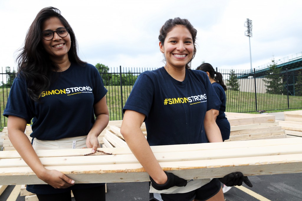 photo of two women MBA students at the Habitat build.